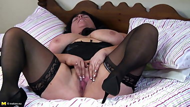 Big busty mom rubs her clit
