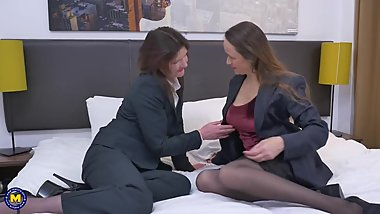 Mature lesbian fucks another mature hairy mom