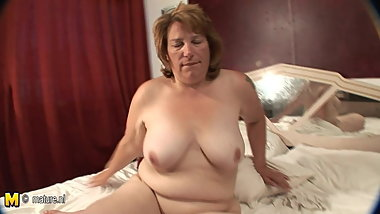 Masturbating grandmother gets warm and horny