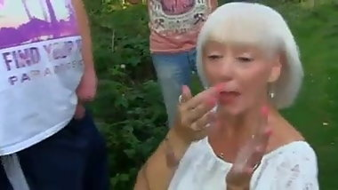granny sucking a lot of cocks in field